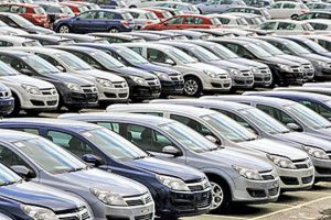 18 May 2006, Ellesmere Port, Cheshire, England, United Kingdom --- Rows of newly manufactured cars await uplift at Vauxhall Motors factory's Vehicle Distribution Centre in Ellesmere Port, Cheshire, northwest England. Vauxhall Motors was a British automobile company, a subsidiary of General Motors Corporation (GM) and part of GM Europe. At the end of 2008 the company employed 2,200 workers producing 180,000 cars a year, or 40 per hour, although the global economic downturn put the Ellesmere Port factory at risk of closure. --- Image by © Colin McPherson/Corbis