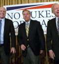 "Sen. John McCain, R-Ariz., left, Republican presidential candidate Sen. Lindsey Graham, center and former Sen. Joe Lieberman, I-Conn., right, arrive on stage at a town hall meeting at the 3 West Club to launch Graham's ""No Nukes for Iran"" tour Monday, July 20, 2015, in New York.  (AP Photo/Kevin Hagen)"